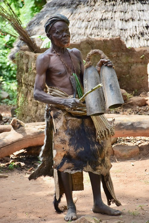 Dupa chief ringing bells to message his tribe members
