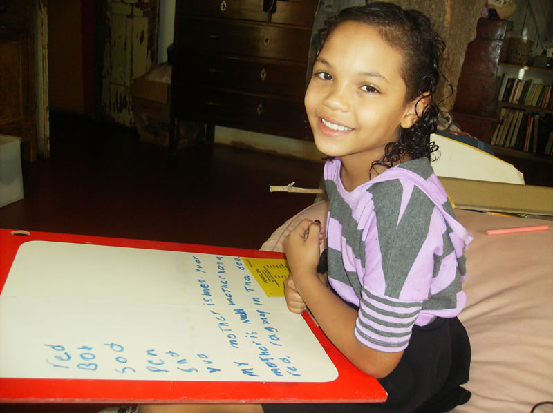 A young private student in Puerto Viejo, Costa Rica learning English