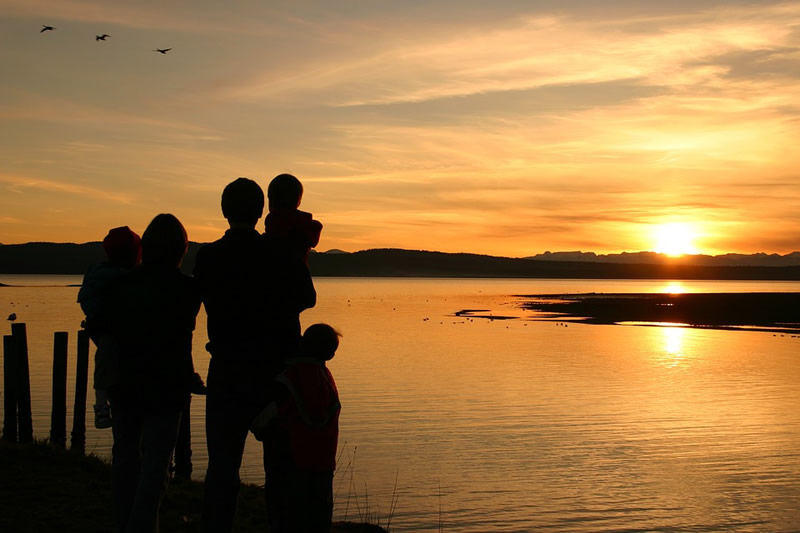 Family traveling and enjoying a sunset abroad