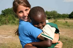 Teen volunteer abroad  with impoverished child