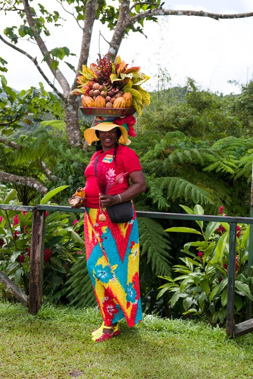 A Grenadian woman shows off the island's abundance of spices