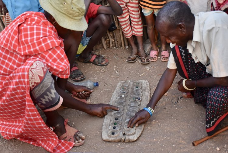 Villagers playing a game called bao