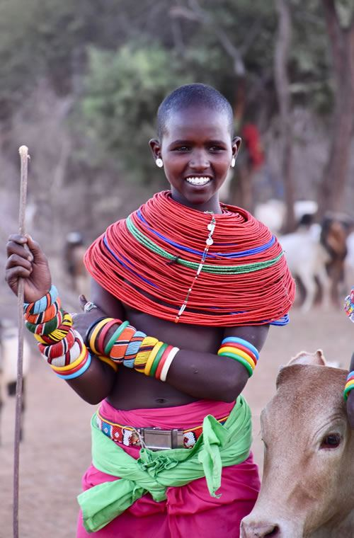 Samburu girl herding cattle