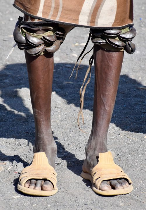Turkana men perform dances with bells on knees