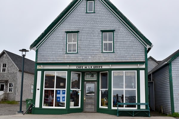 Iconic 'Café de la Grave' in a harbor town