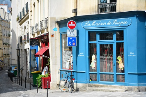 A typical street in Paris where you may find accommodations from Couchsurfing to cheap Airbnb rentals
