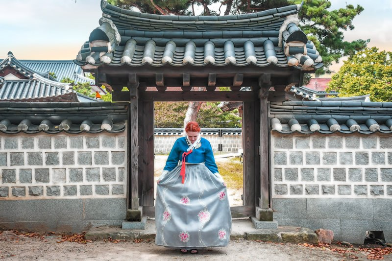 Author in a hanbok, a traditional dress, while living in South Korea