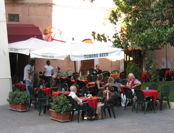 Speaking with Italians in Italy at an outdoor cafe