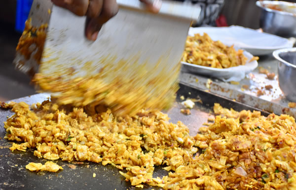 Chopping ingredients for a kottu