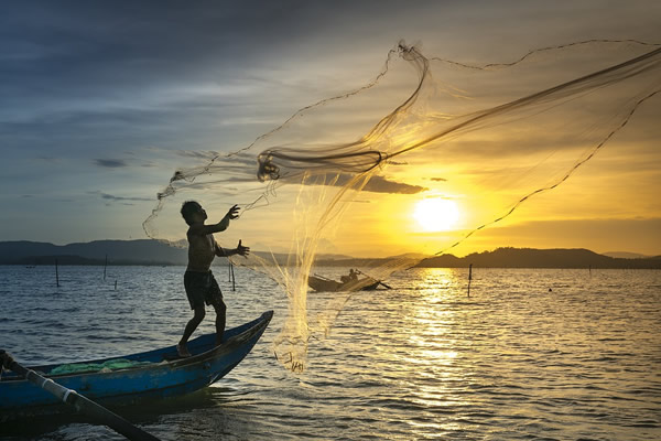 Fishermen at sunset in Vietnam