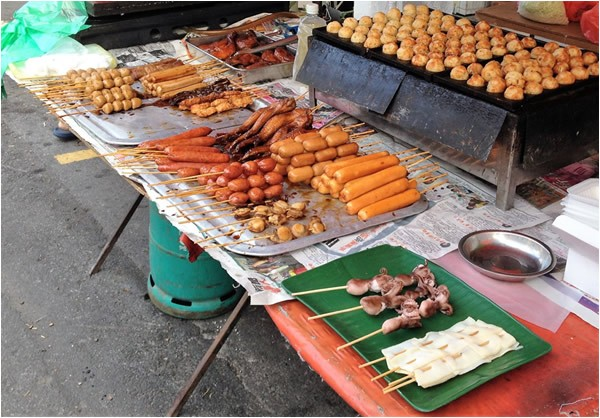 Grilled meat by street food vendors in Thailand