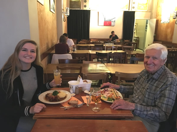Grandfather John with granddaughter Sutton enjoying dinner in Brussels