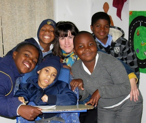 Teacher with students in South Africa