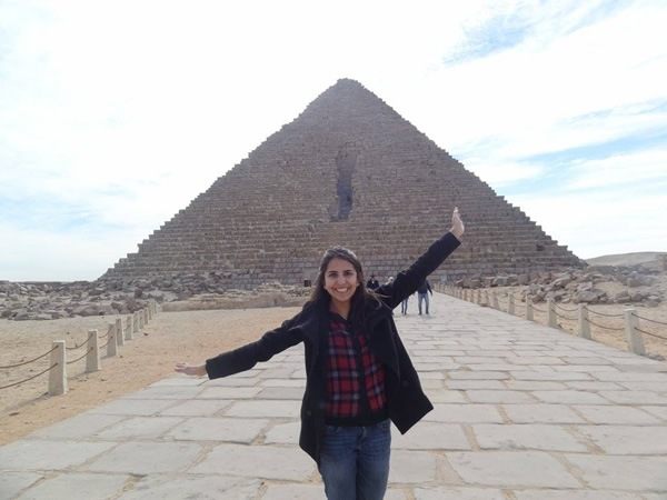 The author in front of a pyramid in Giza, very near Cairo