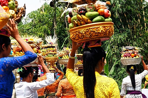 Women carrying fruit to ceremony in Bali