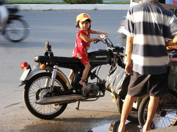 Girl riding bike in Can Tho, Vietnam