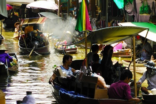 Experience the floating markets of Thailand
