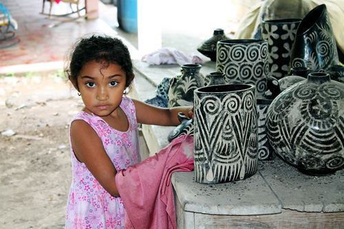 Girl with traditional pottery