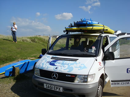 Surfboards loaded on van in Cornwall