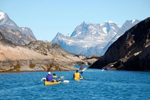Group paddling boats in the Artic