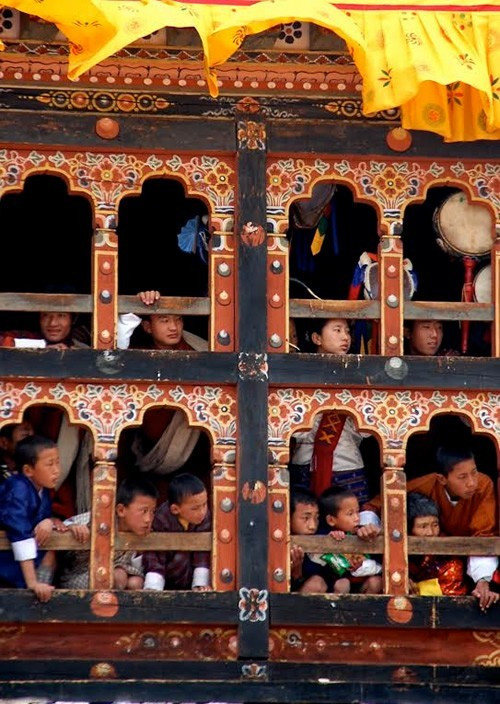 Bhutan children watching festival
