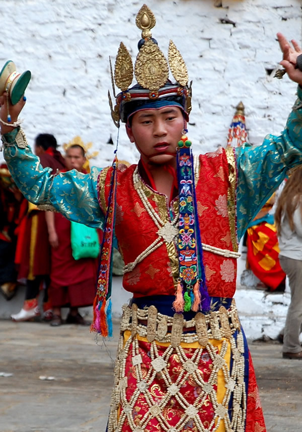 Bhutan Paro festival: dancer with hand bells