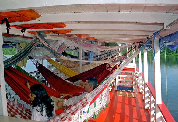Riverboat in Brazil in South America with hammocks on deck