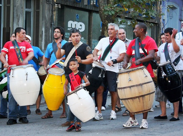 A group of candombe drummers marches through the Barrio Sur neighborhood of Montevideo, Uruguay
