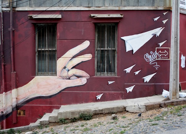 A trompe l'oeil mural adorns a building on Templeman Street in Valparaiso, Chile