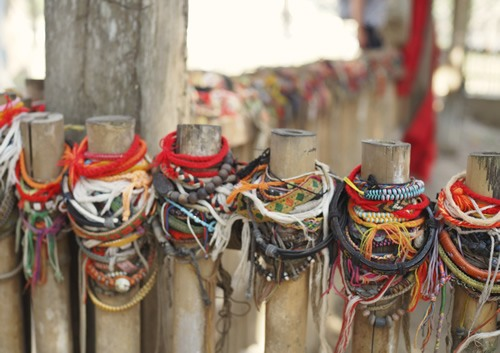 Bracelets left at a memorial at the Killing Fields of Choeung Ek, Cambodia