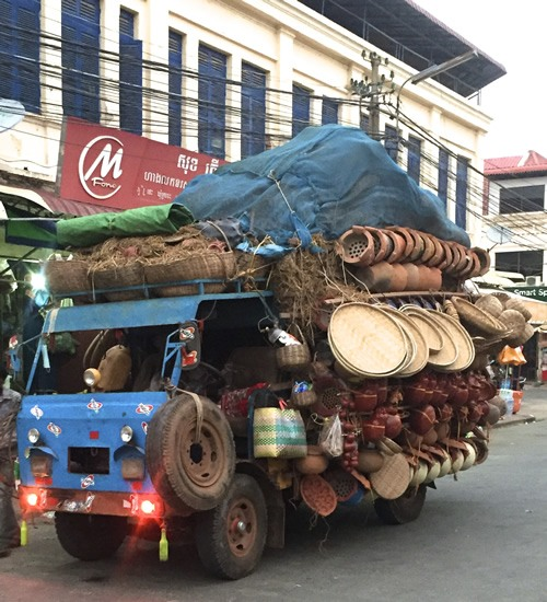 Vendors' vehicles packed to the brim in Cambodia's cities