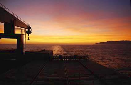Cargo ship travel with a sunset view