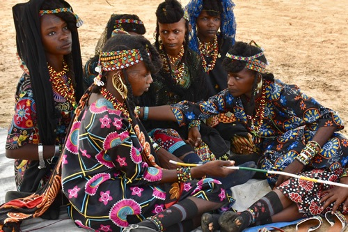 Young marriageable Wodaabe girls biding their time in anticipation of the Gerewol Festival performances