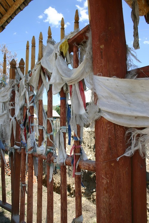 Prayer flags tied to a fence