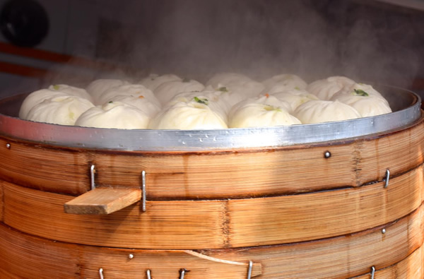 Bamboo steaming basket with dumplings
