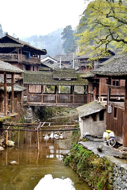 Wooden houses and covered bridge in Dong village