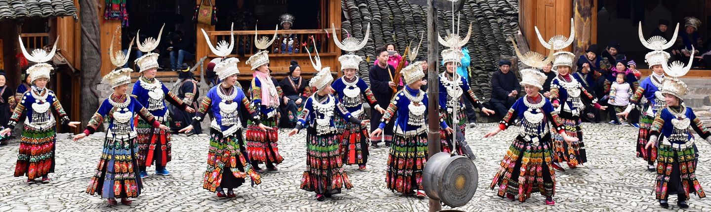 Women dancing at a festival in Guizhou Province, China