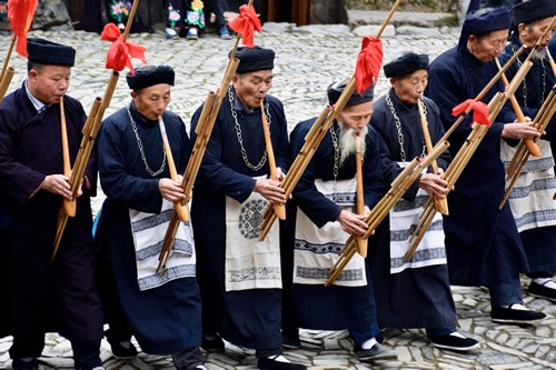 Miao elders playing the lusheng flute