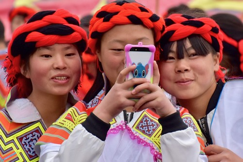Miao women enjoying the festival in Nankai village.