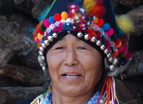 Aini woman with ceremonial headdress