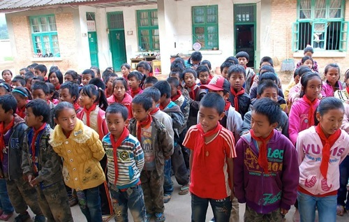 Children assembling in a school yard.