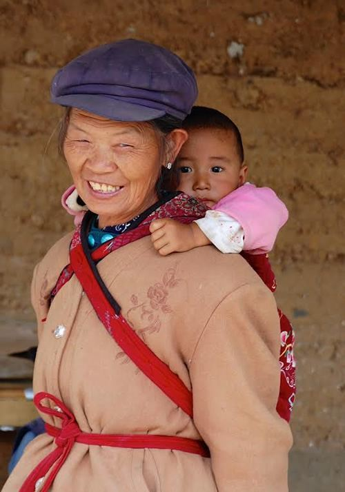 Naxi woman with child