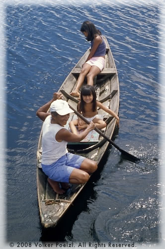 Amazon locals on canoes