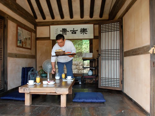 Observe local customs by eating breakfast on a porch hanok
