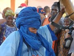 Festival on Niger with man dancing in blue