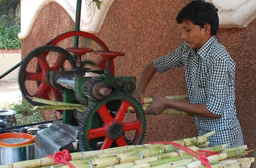 Street vendor selling pressed sugarcane juice