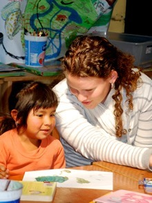 Volunteer teaching Guatemalan child