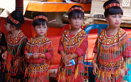 Girls in ceremonial dress for funeral procession