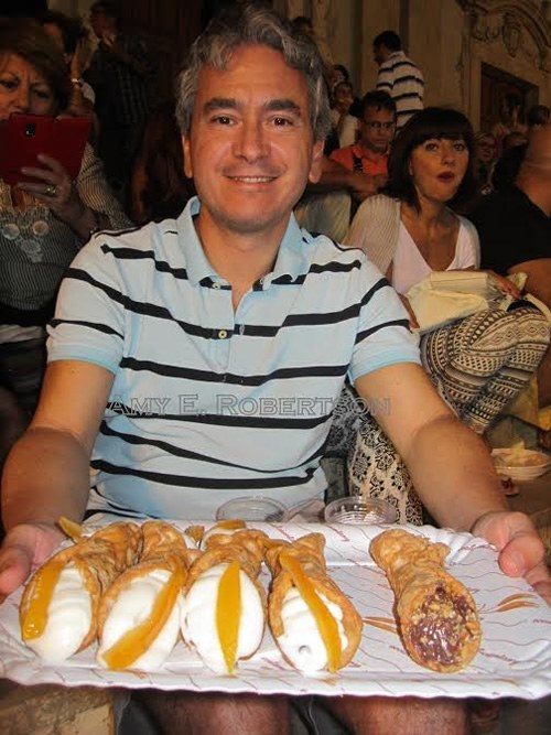 Luca offers cannoli in Sicily