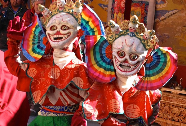 Monks dancing in colorful masks